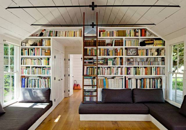 home-library-design-reading-nook-with-bookcase-and-ladder